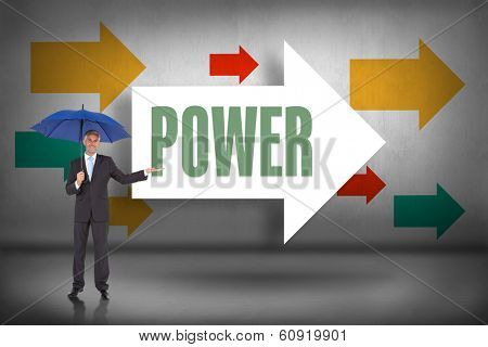 The word power and peaceful businessman holding blue umbrella against arrows pointing