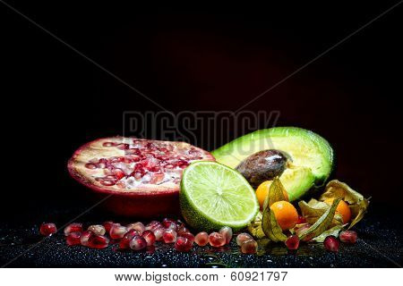 fresh fruits with waterdrops on them and knife