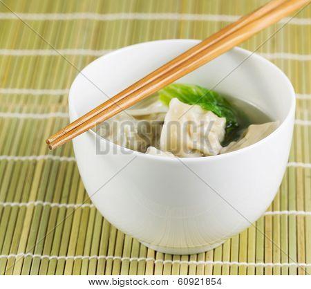 Wonton Soup On Bamboo Mat