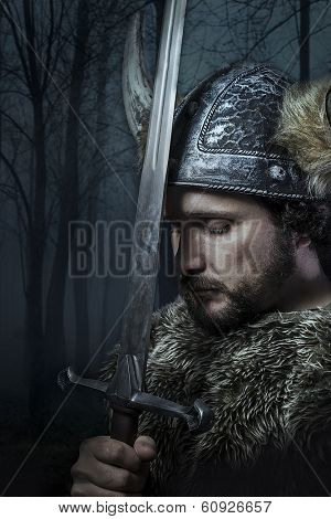 Peace, Viking warrior, male dressed in Barbarian style with sword, bearded