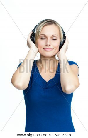 Happy Woman Listening To Music With Closed Eyes
