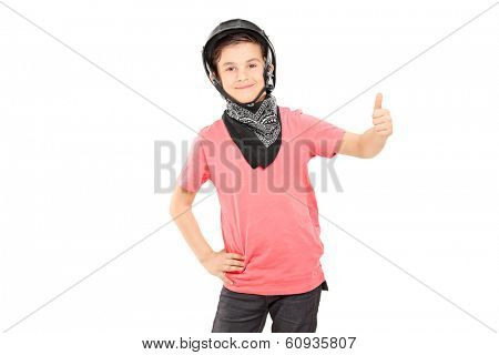 Little boy with bikers helmet giving thumb up isolated on white background