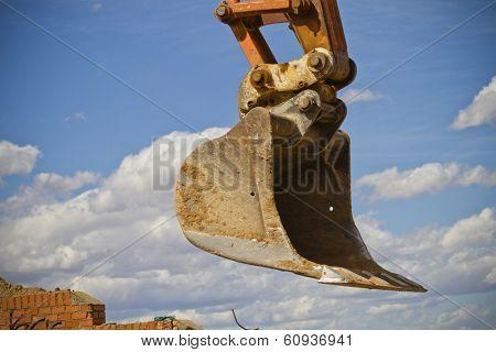 Excavator against cloud sky