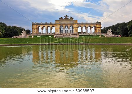 the summer residence of the Austrian Habsburgs. Magnificent colonnade reflected in the smooth water of the pond
