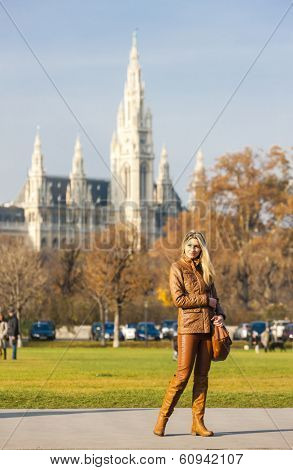woman in the city and city hall of Vienna at background, Austria