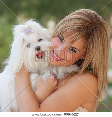 small dog with owner