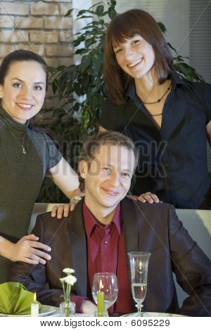 Happy Man With Two Women