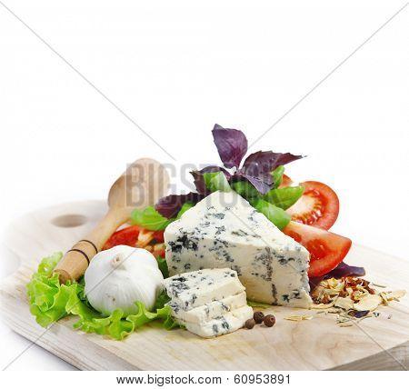 Italian food (cheese, garlic, pepper, basil, salad) over white