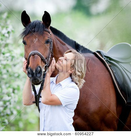 Woman hugging a horse.