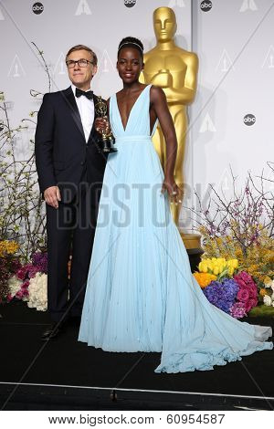 LOS ANGELES - MAR 2:: Christoph Waltz, Lupita Nyong'o  in the press room at the 86th Annual Academy Awards on March 2, 2014 in Los Angeles, California