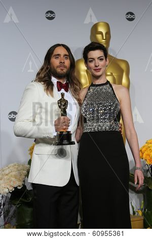LOS ANGELES - MAR 2:: Jared Leto, Anne Hathaway  in the press room at the 86th Annual Academy Awards on March 2, 2014 in Los Angeles, California