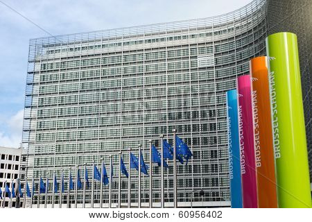 BRUSSELLS - FEB 24, 2014: Photo of European Union flags in front of the Berlaymont building (European commission)
