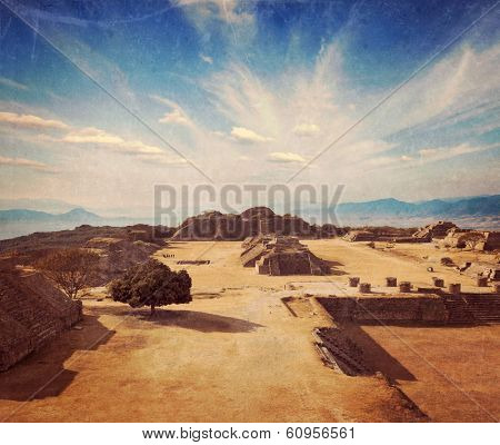 Vintage retro hipster style travel image of ancient civilization ruins on plateau Monte Alban in Mexico with grunge texture overlaid