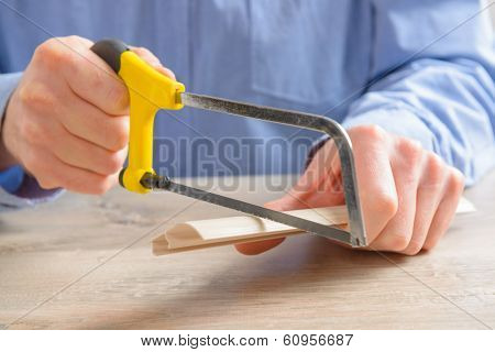 Cutting plastic molding with small handsaw at home