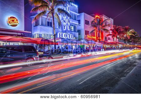 MIAMI, FLORIDA - JANUARY 6, 2014: Cars speed down Ocean Drive. The road is the main thoroughfare through South Beach.