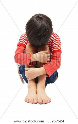 Sad Little Boy Sitting Face Down On Knees