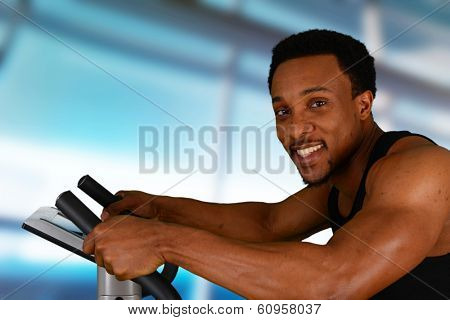 Man working out while at the gym on bike