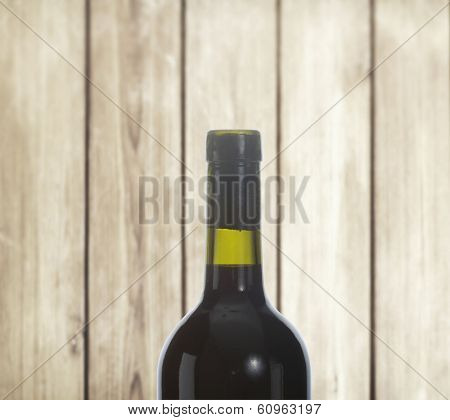 Red Wine bottle on wood background
