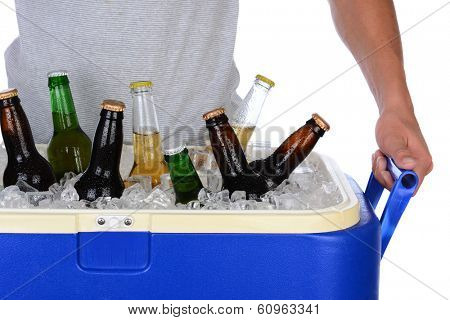 Closeup of a fit young man carrying an ice chest full of beer. Man is wearing a T-shirt top showing torso only. Horizontal format isolated on white.