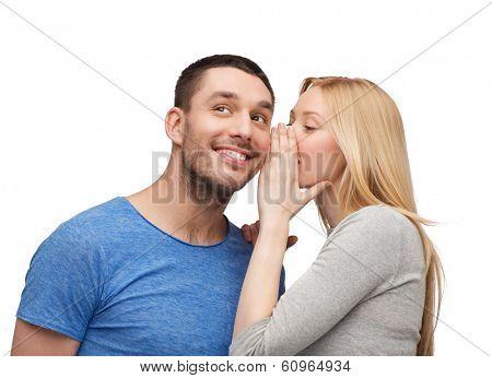 relationships, love and couple concept - smiling girlfriend telling boyfriend secret