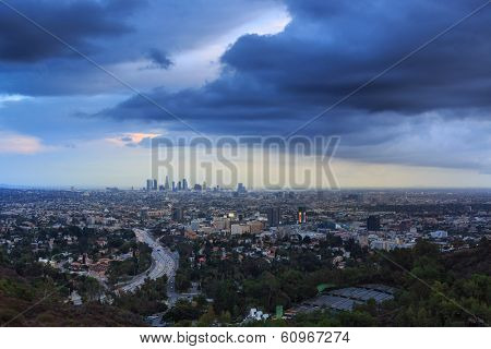 Los Angeles city skyline cityscape with beautiful storm clouds sky background.