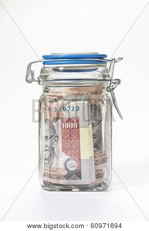 Indian rupee notes sealed in a glass jar
