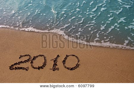 New year 2010 inscription on the sand near the azure sea