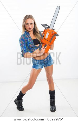 beautiful girl with a chainsaw
