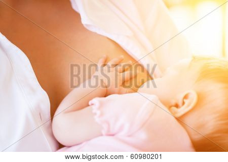 Mother nursing baby by breastfeeding