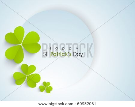 Happy St. Patrick's Day celebration concept with beautiful four leaves lucky clover and stylish text on blue, can be use as sticker, tag or label.