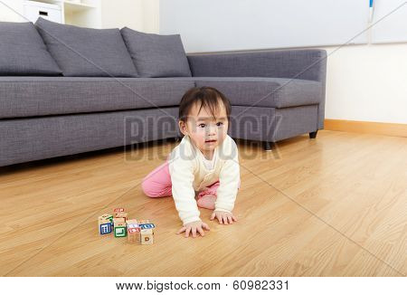 Asia baby girl creeping at home