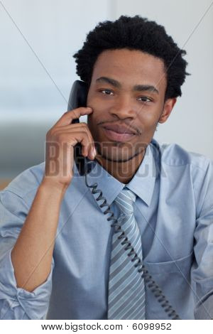 Portrait Of Afro-american Businessman On Phone In Office