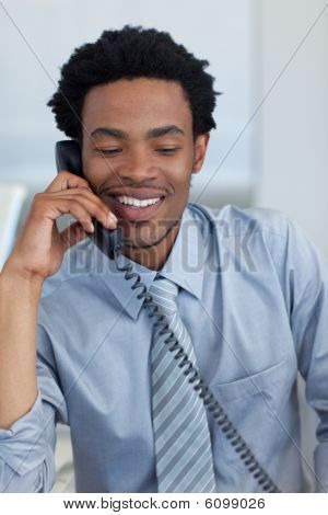 Afro-american Businessman On Phone In Office