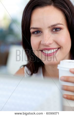 Portrait Of A Smiling Businesswoman Working In Office
