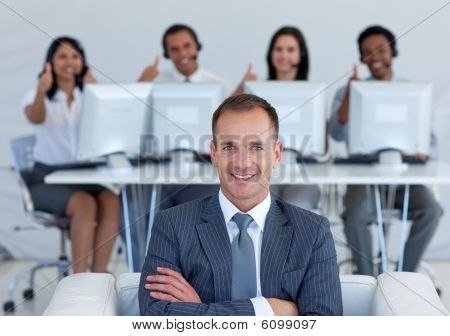 Manager In Call Center With His Team With Thumbs Up