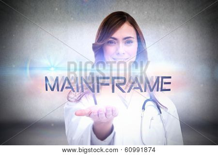 The word mainframe and portrait of female nurse holding out open palm against grey wall