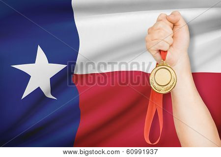 Medal In Hand With Flag On Background - Lone Star, Texas