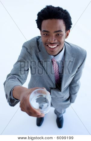 Smiling African Businessman Holding A Glass Of Water