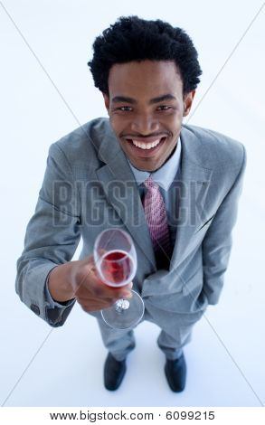 Smiling Afro-american Businessman Holding A Glass Of Wine