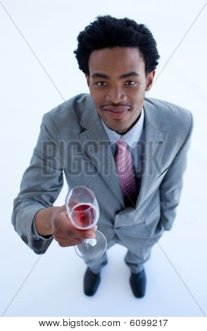 Afro-american Businessman Holding A Glass Of Wine