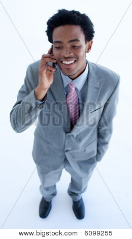 Afro-american Businessman Speaking On A Mobile Phone