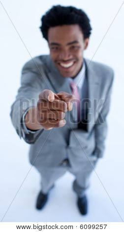 Smiling African Businessman Pointing At The Camera