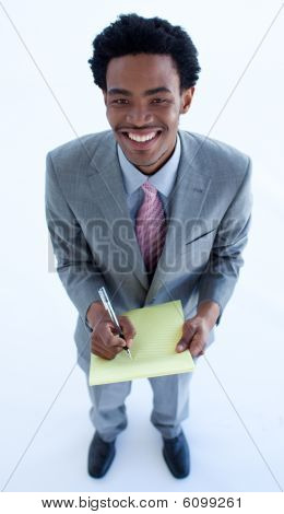 High Angle Of Businessman Writing Notes