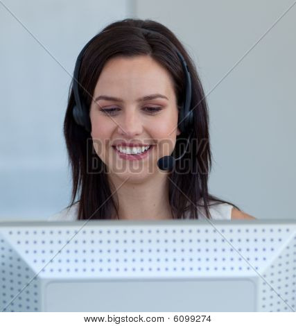 Beautiful Businesswoman In A Call Centre With A Headset On