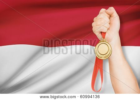 Medal In Hand With Flag On Background - Principality Of Monaco