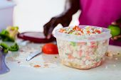 stock photo of conch  - Close up of Bahamian woman making traditional conch salad - JPG