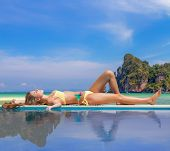 Woman by the swimming pool  on Ko Phi Phi island in Thailand