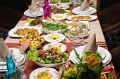 stock photo of buffet lunch  - Table with various food served in a restaurant - JPG