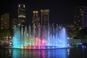 stock photo of klcc  - Lake Symphony Musical Water Fountain Light Show at Night in KLCC Park Kuala Lumpur Malaysia - JPG