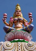 pic of lakshmi  - Goddess Lakshmi on top of the entrance gate at Sripuram the Golden Temple in Vellore Tamil Nadu India - JPG